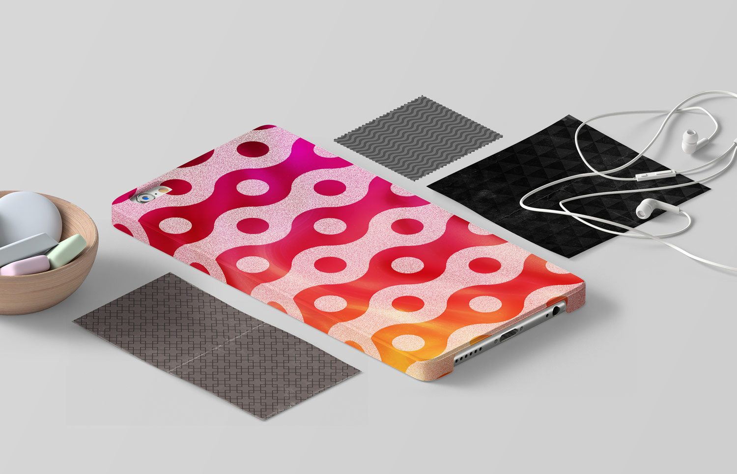 Various patterns on a phonecase, paper, and cloth